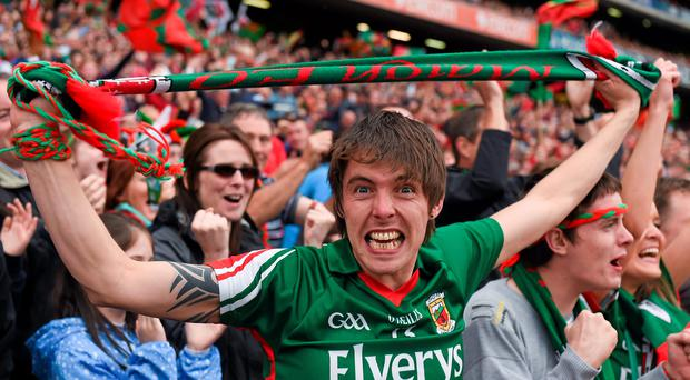 A supporter celebrates after Mayo had scored a goal from the penalty spot. GAA Football All-Ireland Senior Championship, Semi-Final, Kerry v Mayo, Croke Park, Dublin. Picture credit: Ray McManus / SPORTSFILE