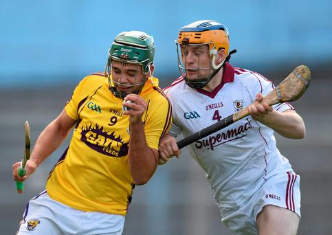 Conor Devitt, Wexford, in action against Paul Killeen, Galway