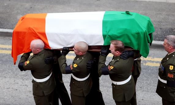 The coffin containing the remains of former Taoiseach Albert Reynolds is removed from Mansion House, Dublin, after lying in state prior to his funeral on Monday. PRESS ASSOCIATION Photo. Picture date: Saturday August 23, 2014. See PA story DEATH Reynolds. Photo credit should read: Brian Lawless/PA Wire