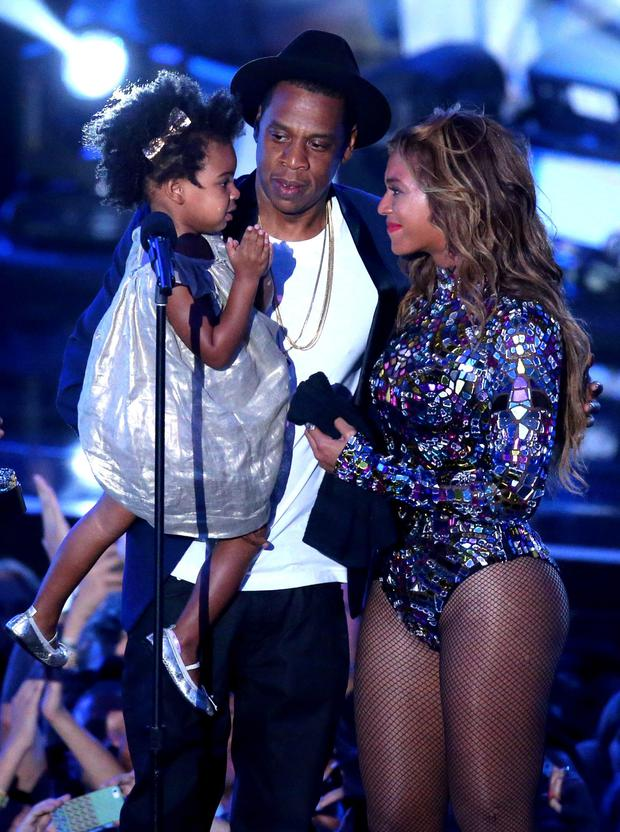 Rapper Jay Z and singer Beyonce with daughter Blue Ivy Carter onstage during the 2014 MTV Video Music Awards