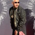 Chris Brown arrives on the red carpet at the MTV Video Music Awards