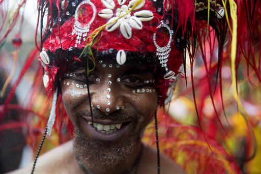 A performer poses during the Notting Hill Carnival in west London August 25, 2014. Reuters/Neil Hall