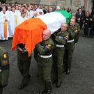 Kathleen Reynolds flanked by two sons Albert (left) and Philip follow the coffin of former Taoiseach Albert Reynolds