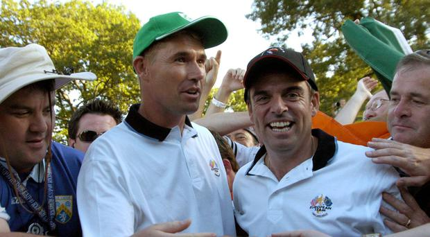 Flashback to September 2004: Padraig Harrington and Paul McGinley celebrate after beating Tiger Woods and Daviod Love in foursomes at the Ryder Cup at Oakland Hills. Photo: Matt Browne / SPORTSFILE
