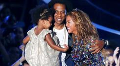 Beyonce smiles with Jay-Z and daughter Blue Ivy during the 2014 MTV Video Music Awards