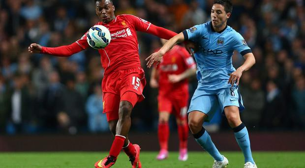 Liverpool striker Daniel Sturridge holds off Samir Nasri of Manchester City last year