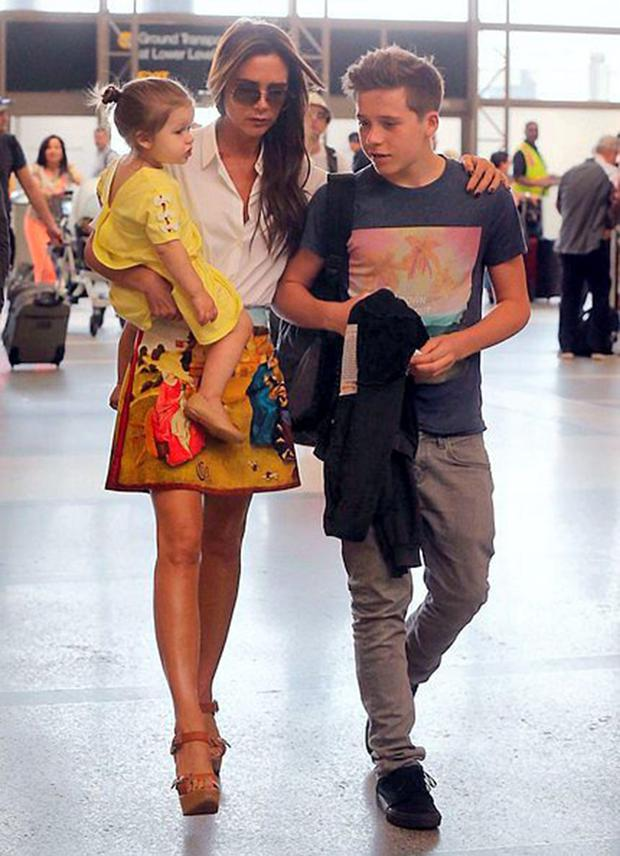 Victoria Beckham with eldest son Brooklyn and daughter Harper