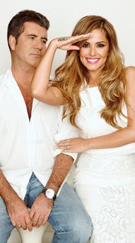 Simon Cowell and Cheryl Fernandez-Versini as they appear in this week's Radio Times