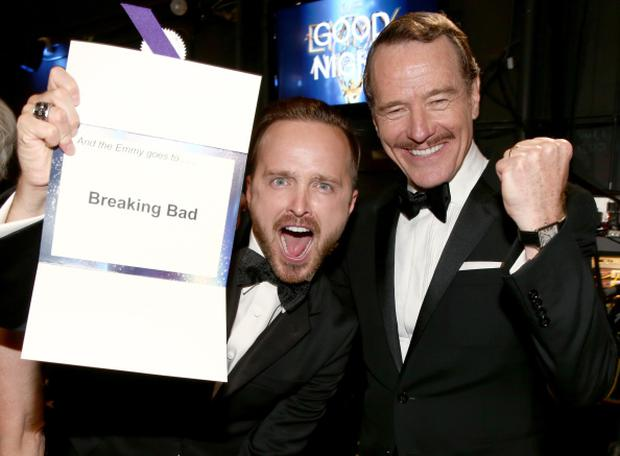 LOS ANGELES, CA - AUGUST 25: 66th ANNUAL PRIMETIME EMMY AWARDS -- Pictured: (l-r) Actors Aaron Paul and Bryan Cranston, winners of Outstanding Drama Series for