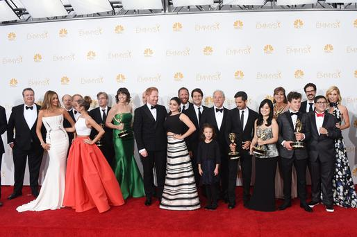 "LOS ANGELES, CA - AUGUST 25: Actors Sarah Hyland, Sofía Vergara, Aubrey Anderson-Emmons, Julie Bowen, Ariel Winter, Jesse Tyler Ferguson, Nolan Gould, Rico Rodriguez, Eric Stonestreet and Ed O'Neill with Show Producers, winners of the Outstanding Comedy Series Award for ""Modern Family"" pose in the press room during the 66th Annual Primetime Emmy Awards held at Nokia Theatre L.A. Live on August 25, 2014 in Los Angeles, California. (Photo by Jason Merritt/Getty Images)"