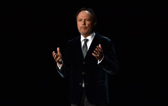 Actor Billy Crystal speaks onstage at the 66th Annual Primetime Emmy Awards held at Nokia Theatre L.A. Live on August 25, 2014 in Los Angeles, California. (Photo by Kevin Winter/Getty Images)