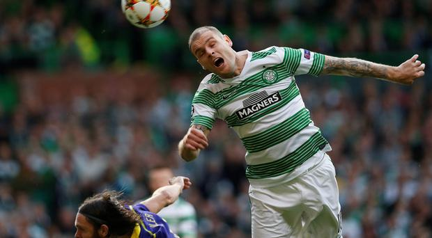 Celtic's Anthony Stokes (R) challenges NK Maribor's Marko Suler during their Champions League soccer match in Celtic Park Stadium