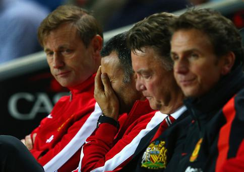 Assistant manager Ryan Giggs looks dejected with manager Louis van Gaal of Manchester United during the Capital One Cup defeat to the MK Dons