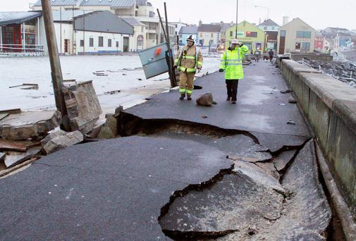 The scenes of devastation at Lahinch promenade in Co Clare after last year's storms, where massive walls and quarter tonne wall cappings were tossed across the car park. Photo: Press 22