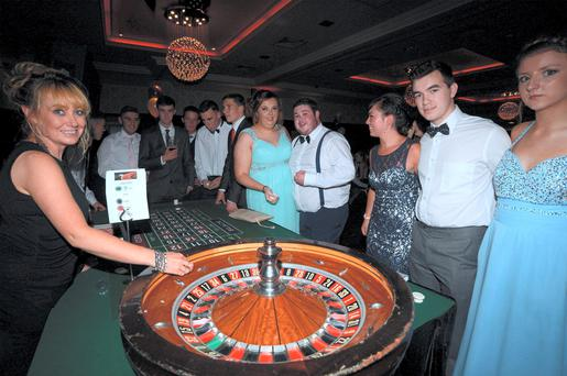 Students from St Marys CBS Portlaoise DEBS night enjoy roulette at their Casino Royale-themed night in teh Red Cow Hotel