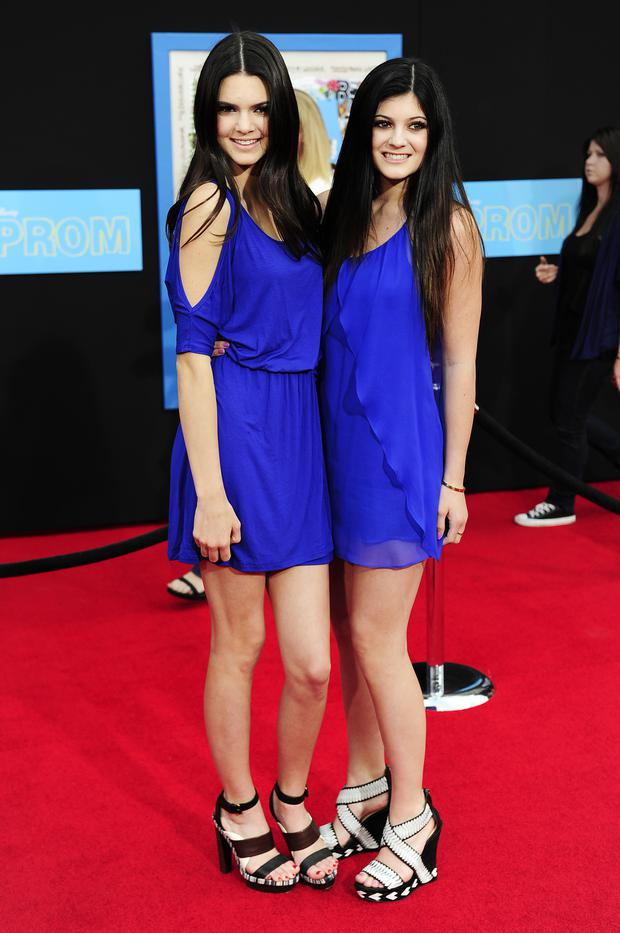 Sisters and television personalities, Kendall Jenner (L) and Kylie Jenner, arrive for the world premiere of Disney's