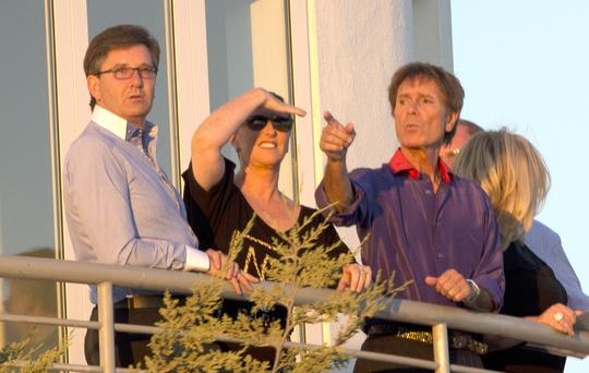 Sir Cliff Richard together with companion John McEllyn and several friends, including Daniel O'Donnell enjoy the sunset and a bottle of Bollinger champagne from the balcony of the pizzeria Bellavita on the coast of Portugal