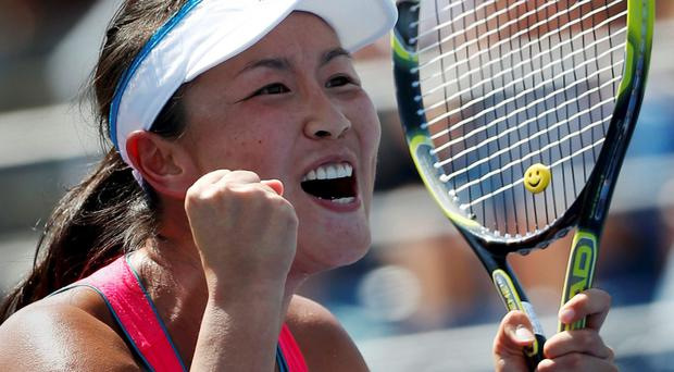 Peng Shuai of China celebrates after defeating Agnieszka Radwanska of Poland during their match at the 2014 U.S. Open