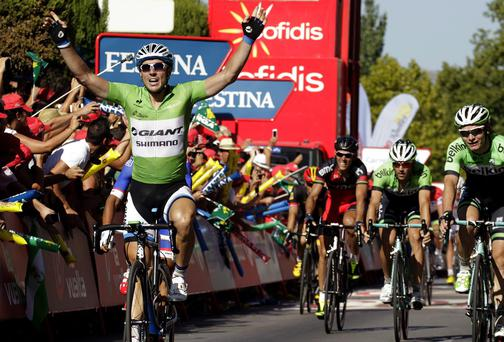 Giant Shimano's German rider John Degenkolb celebrates as he crosses the finish line to win stage five of the Vuelta a Espana. Photo: JOSE JORDAN/AFP/Getty Images