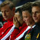 Ryan Giggs shows his frustration along with the rest of the coaching staff during Manchester United's defeat to MK Dons. Photo: Clive Mason/Getty Images