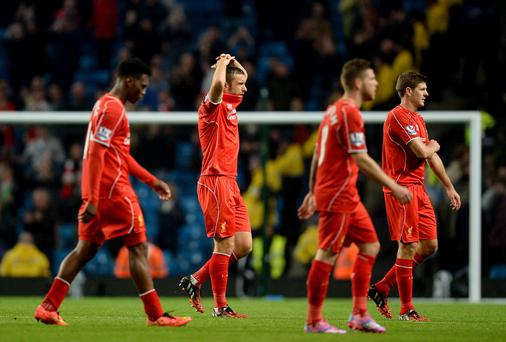 Liverpool players look dejected after the final whistle during the Barclays Premier League match at the Etihad Stadium on Monday