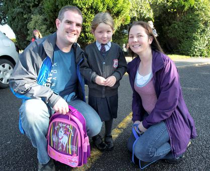 Caoimhe Lynn (4) with Dad Kevin and Mum Alison on her first day at school at the Holy Family in Rivervalley Swords