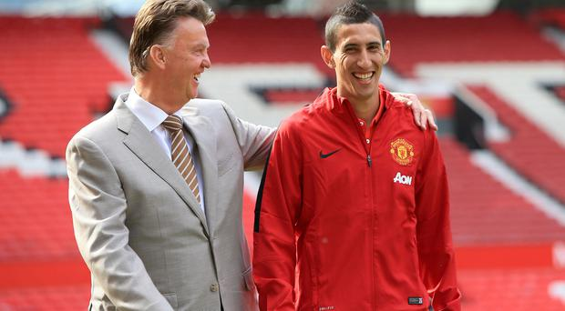 Manchester United manager Louis van Gaal with Angel di Maria during a photo call at Old Trafford today