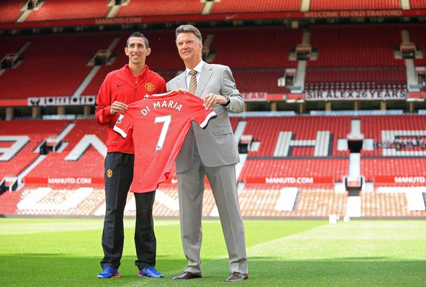 Manchester United manager Louis van Gaal with Angel di Maria during a photo call at Old Trafford, Manchester. PRESS ASSOCIATION Photo. Picture date: Thursday August 28, 2014. See PA story SOCCER Man Utd. Photo credit should read: Peter Byrne/PA Wire. RESTRICTIONS: Editorial use only. Maximum 45 images during a match. No video emulation or promotion as 'live'. No use in games, competitions, merchandise, betting or single club/player services. No use with unofficial audio, video, data, fixtures or club/league logos.