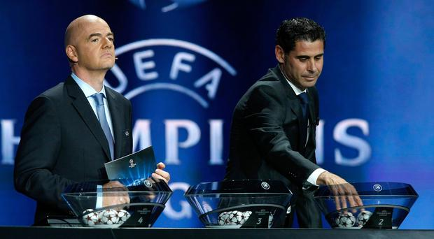 Former Real Madrid captain Fernando Hierro and General Director Gianni Infantino looks on during the UEFA Champions League draw in Monaco