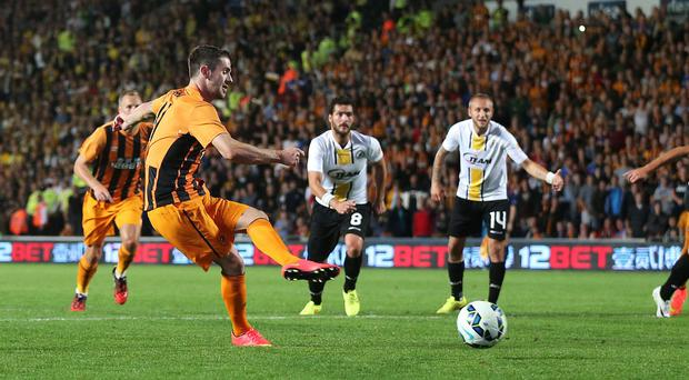 Hull City's Robbie Brady scores his sides second goal from the penalty spot during the UEFA Europa League Qualifying Play-off second leg at the KC Stadium