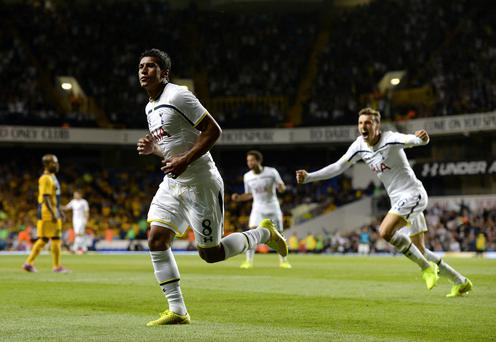 Tottenham Hotspur's Paulinho celebrates scoring his sides second goal of the game