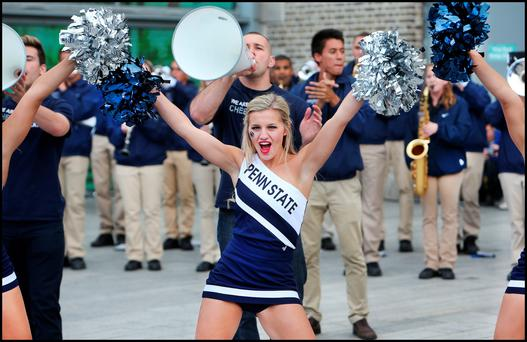 Penn State cheerleader Maddie Miller who along with rival team UFC'S (University of Central Florida) cheerleaders and marching bands held a display at the CHQ on Dublins Docklands ahead of Saturdays game at Croke Park