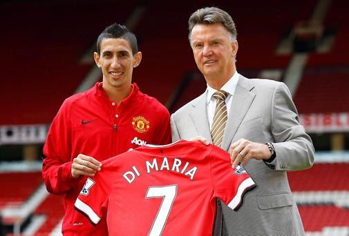 Manchester United's new signing Angel Di Maria poses for a photograph with his shirt and manager Louis van Gaal at Old Trafford