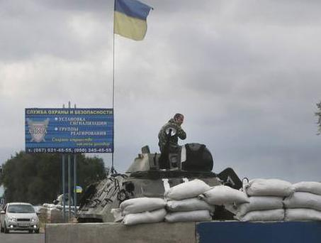 Ukrainian forces guard a checkpoint in the town of Mariupol, eastern Ukraine, which pro-Russian separatists claim is a major target in their rebellion against the government (AP)