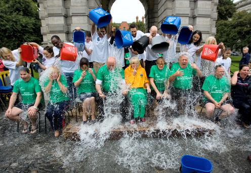 Trinity College Dublin neurologists and research students do the dunking at the ice bucket challenge for politicians including Mary Hanafin, Roisin Shortall, Caoimhghin O Caolain, Mary Mitchell O'Connor, Mairead McGuinness, Joe Costello, Richard Boyd Barrett, and Gabrielle McFadden. Photo: Jean Curran.