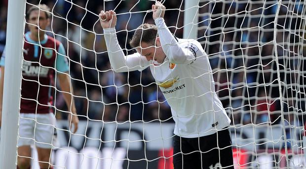 Manchester United's Wayne Rooney reacts during the Barclays Premier League match at Turf Moor
