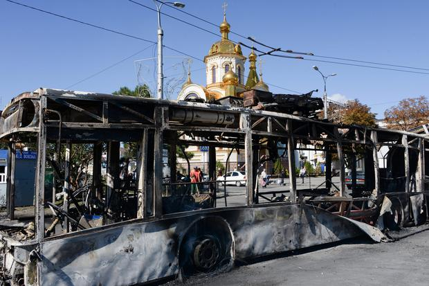 A burned trolleybus is seen near Donetsk train station after shelling, Donetsk