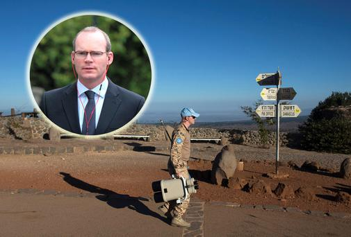 Pressure is mounting on Minister Simon Coveney (inset) about the situation in Golan Heights