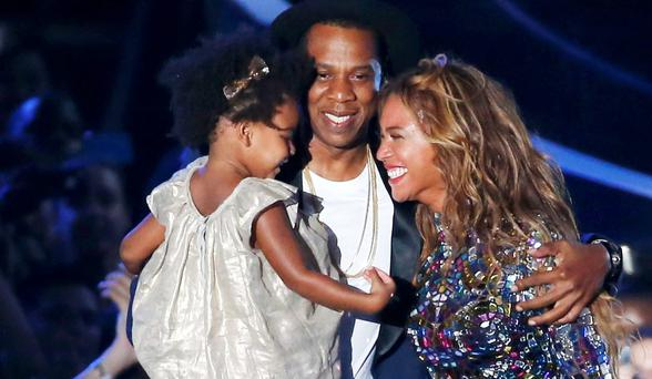 Beyonce smiles with Jay-Z and daughter Blue Ivy (REUTERS/Lucy Nicholson)