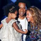 Beyonce smiles with Jay-Z and daughter Blue Ivy after accepting the Video Vanguard Award on stage during the 2014 MTV Video Music Awards in Inglewood, California. While the singer speaks plainly about her love for daughter Blue Ivy, there is no mention of her husband, Jay-Z (REUTERS/Lucy Nicholson)