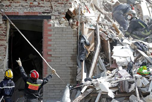 French firefighters search the rubble of a collapsed building in Rosny-Sous-Bois, near Paris