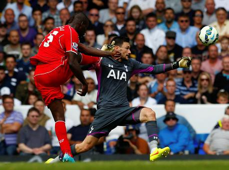 Liverpool's Mario Balotelli shoots wide past Tottenham Hotspur's Hugo Lloris at White Hart Lane