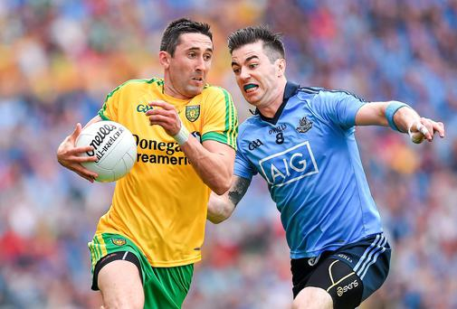 Donegal's Rory Kavanagh skips away from Michael Darragh Macauley of Dublin during the All-Ireland SFC semi-final at Croke Park. Photo: Brendan Moran / SPORTSFILE
