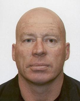 A manhunt for Tully (48) is underway Monday, Sept. 1, 2014, after police said a gunman killed two people and injured a third at an unemployment office before escaping on a bicycle in Ashburton, New Zealand. (AP Photo/New Zealand Police)