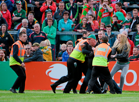 A disgruntled Mayo supporter is restrained as he tries to confront referee Cormac Reilly during the closing stages of the game. GAA Football All Ireland Senior Championship, Semi-Final Replay, Kerry v Mayo, Gaelic Grounds, Limerick. Picture credit: Dáire Brennan / SPORTSFILE