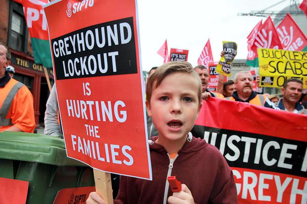 Lee Reilly, age 9, Coolock with his dad and other Greyhound bins workers marching on City Hall to protest in support of the workers on strike at Greyhound Bins. Picture:Arthur Carron