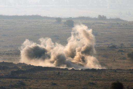 Syrian army soldiers are seen during a battle with rebel fighters in Syria near the border fence with the Israeli-occupied Golan Heights September 1, 2014. REUTERS/Baz Ratner