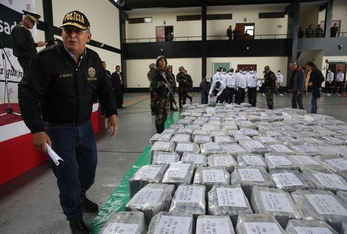 Peru's Interior Minister Daniel Urresti talks with the press during the presentation of seized drugs at a police base in Lima, Peru, Monday, Sept. 1, 2014. (AP Photo/Martin Mejia)