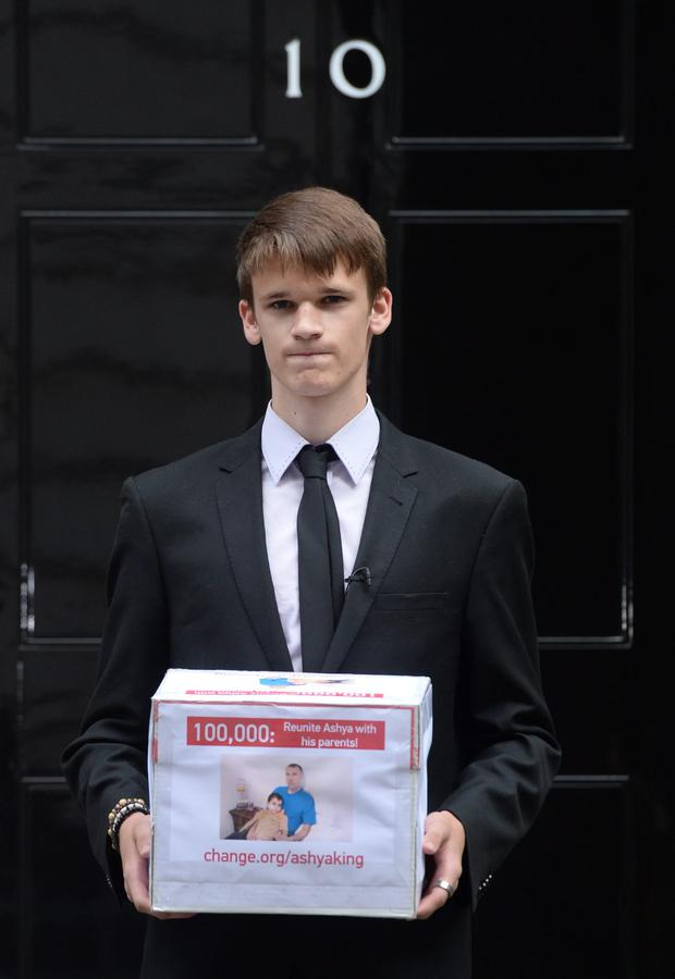16 year old Ethan Dallas, friend of the family of brain tumour patient Ashya King, delivers a petition of over 100,000 names calling for his parents release from a Spanish jail in Madrid
