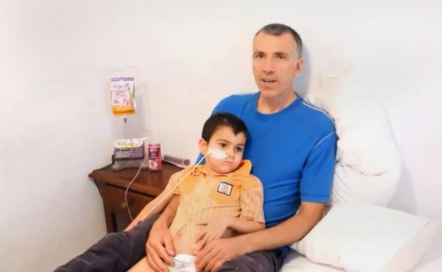 Undated video grab taken from a video posted on YouTube by Naveed King showing Bret King with his son Ashya and explaning why he was taken by his parents from hospital without doctors' consent